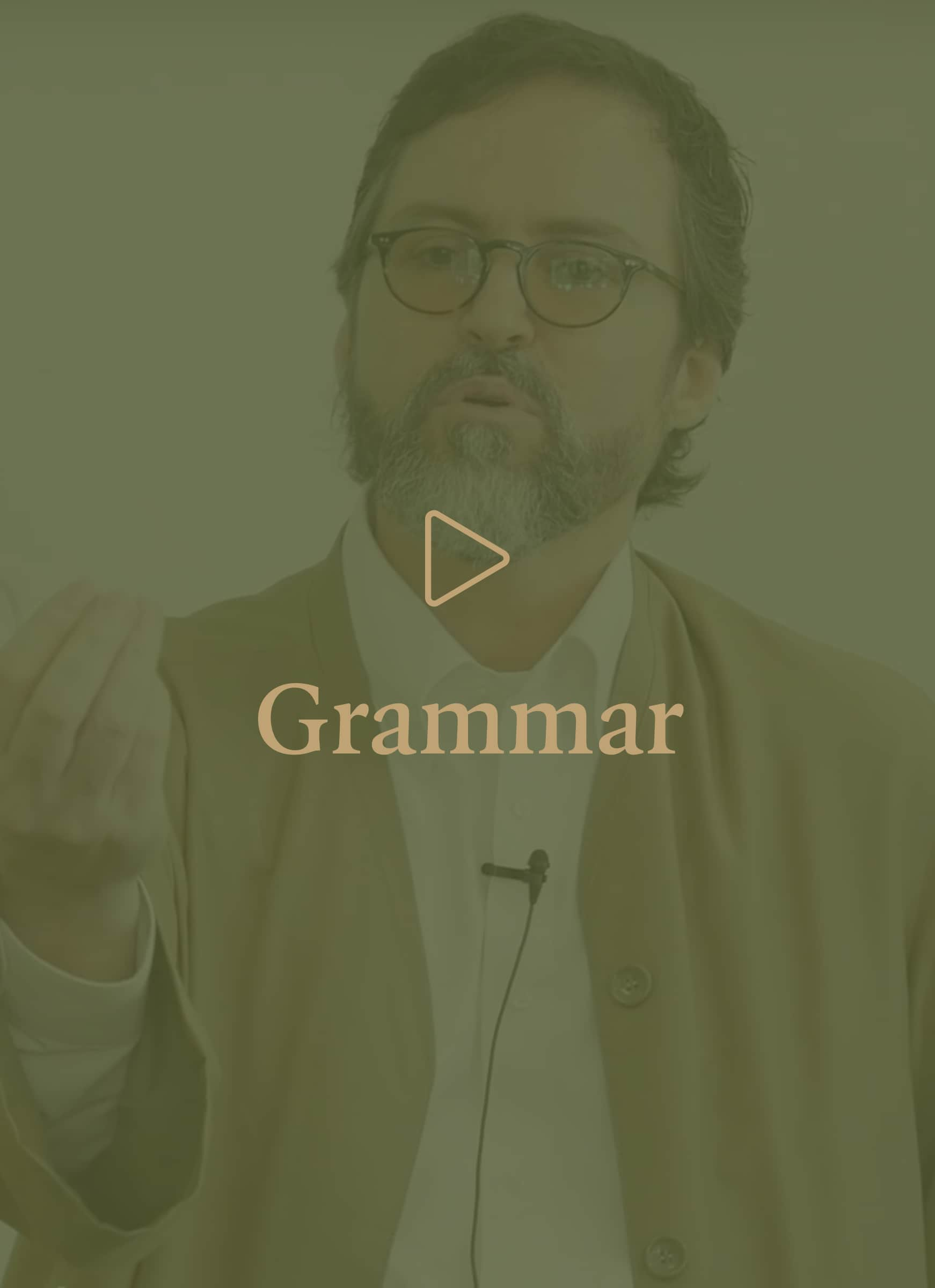 Hamza Yusuf image with overlay of play icon with Grammar title.